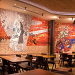 """Coming to the city"", 2010-2011. Collaboration to the project of Spier Architectural Arts school (South Africa), on a drawing by Clive Van den Berg. Installed at Nando's restaurant, Kings Cross, Londra. 50 mq"