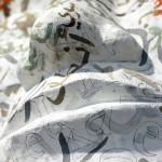 """Mohamed Chabarik, """"Emigrare senza integrarsi è come viaggiare dentro a una valigia"""" -serie """"A viso aperto"""", 2018. 120 x 80 cm ca. Foto Gianluca Bacchetti"""