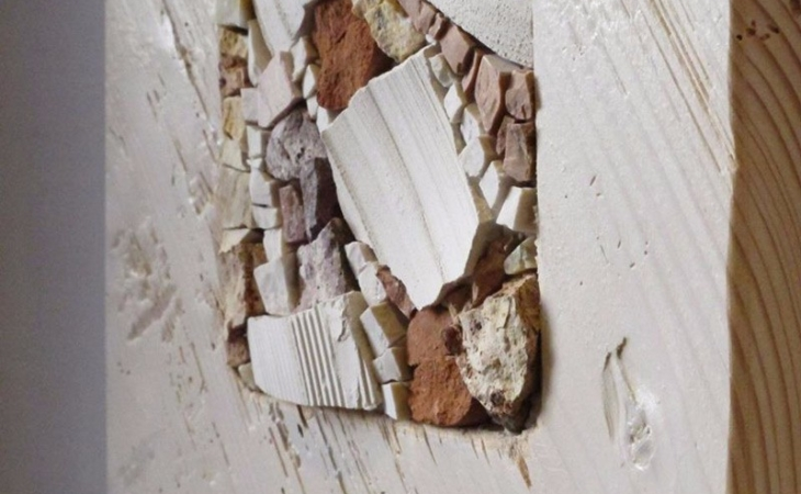 detail of the collection of mosaics with recycled wood